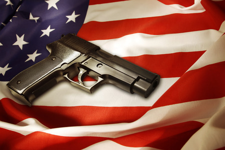 Handgun lying on American flag photo