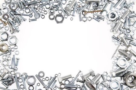 Chrome nuts and bolts on plain background photo