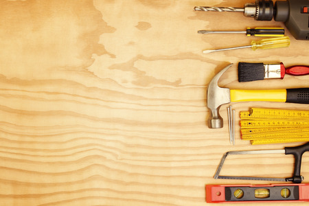 drill floor: Assorted work tools on wood