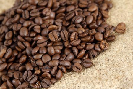 Closeup of coffee beans on sacking photo