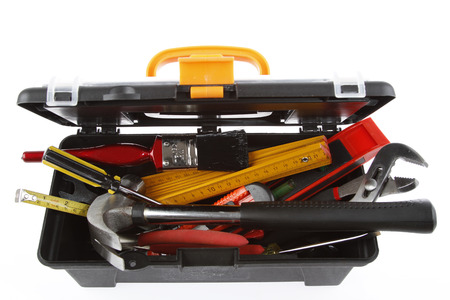 toolkit: Tools in open toolbox on plain background