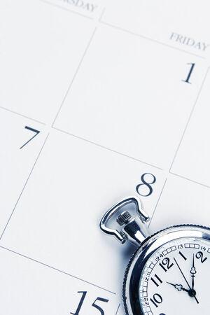 meeting agenda: Pocket watch on calendar page