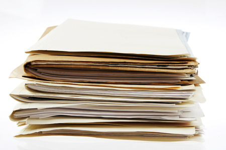 Pile of files on plain background photo
