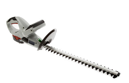 trimmers: New cordless hedge trimmer isolated on plain background Stock Photo