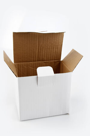 cardboard cutout: Open cardboard box on plain background