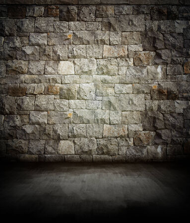 Dark floor and rock wall photo