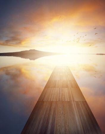 Boardwalk on lake at sunrise photo