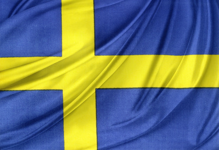 the swedish flag: Closeup of silky Swedish flag Stock Photo