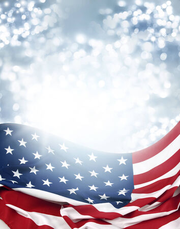 American flag in front of bright blurry background photo