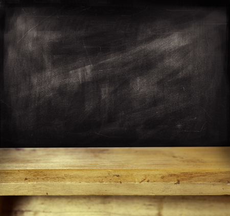 Empty shelf in front of blackboard photo