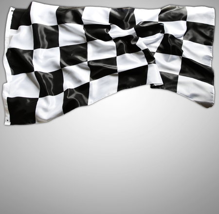 Checkered black and white flag on grey photo
