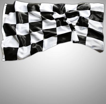 Checkered black and white flag on grey photo