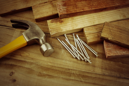 Hammer and nails on wood  photo