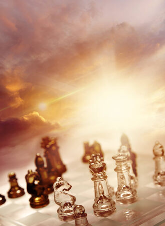 Game of chess pieces in front of bright sky Stock Photo