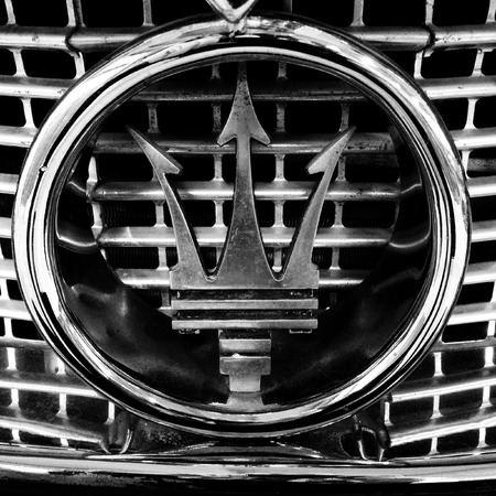 Closeup of old Maserati badge photo