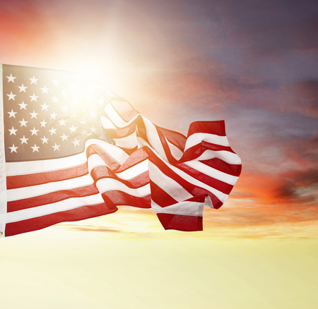 American flag flying in bright sky photo