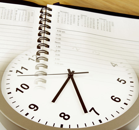 Clock face and diary pages