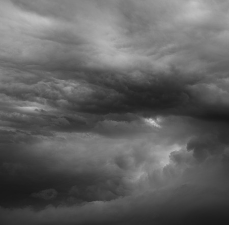 ominous: Dark ominous grey storm clouds. Dramatic sky Stock Photo