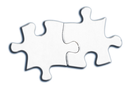 Two connected jigsaw puzzle pieces isolated on white background photo