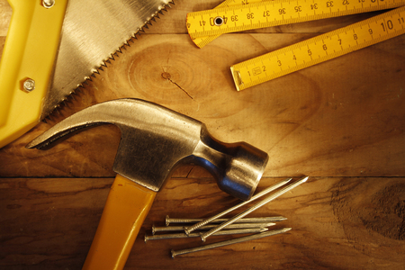 tools construction: Hammer, nails, saw and folding ruler on wood  Stock Photo