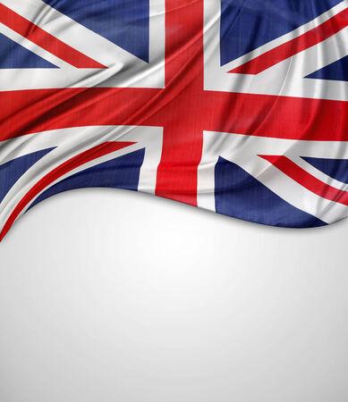 british english: Closeup of Union Jack flag on plain background Stock Photo