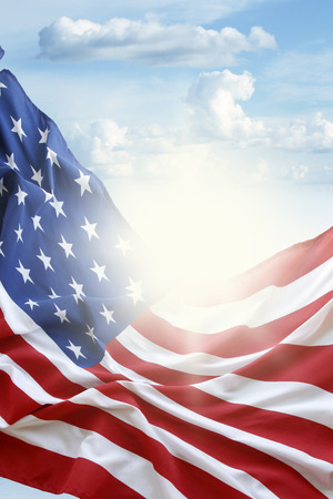 American flag in blue sky Stock Photo