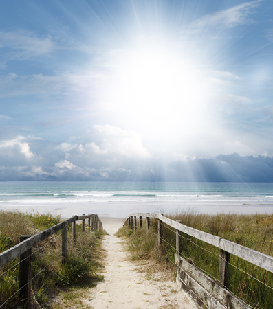 sunlight sky: Pathway leading to the beach
