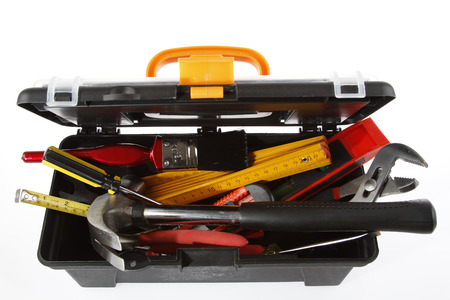 Tools in open toolbox on plain background photo
