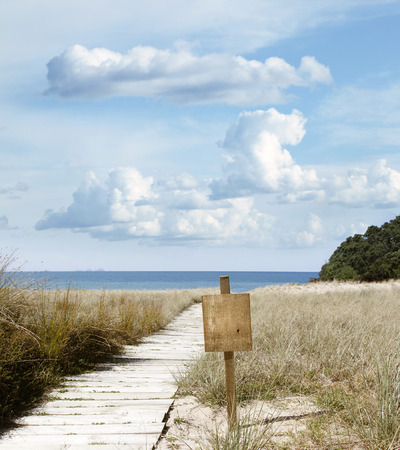 boardwalk trail: Boardwalk trail and blank sign at beach  Stock Photo