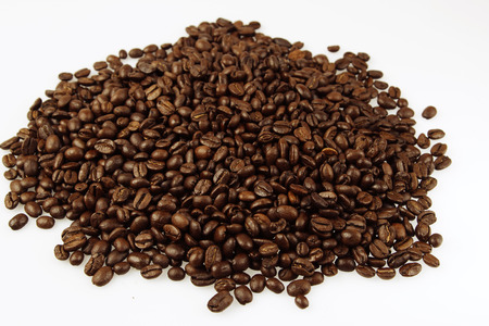 Closeup of coffee beans on plain background photo