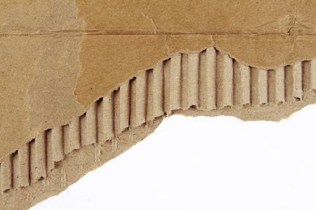 Ripped corrugated cardboard on plain background photo