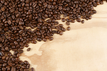 Closeup of coffee beans on wood. Copy space photo