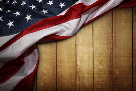 the united states flag: Closeup of American flag on wooden background Stock Photo
