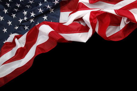 Closeup of American flag on dark background