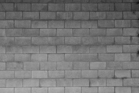 cemento: Primer plano de la pared de bloque gris