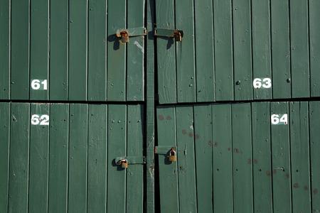 padlocked: Padlocks on closed green doors