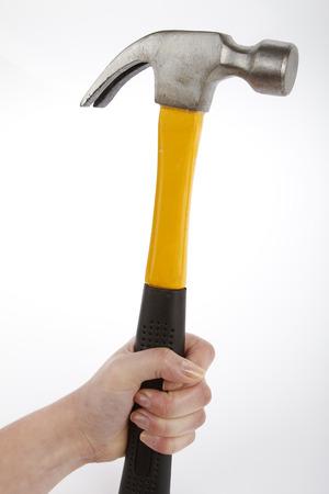 Female hand holding a hammer photo