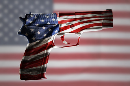 Handgun and American flag composite Stock Photo