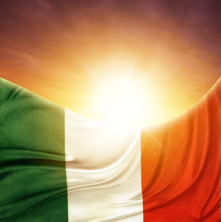Italian flag in front of bright sky