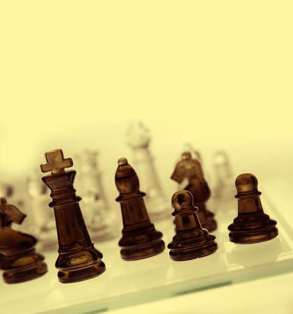 chessmen: Game of glass chess pieces Stock Photo