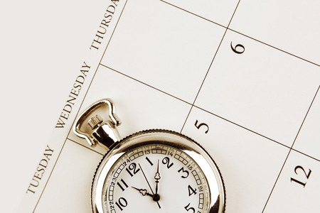 Closeup of watch on calendar photo