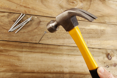 hammered: A nail being hammered into wood  Stock Photo