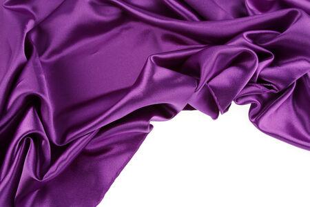 purple silk: Closeup of purple silk fabric on plain background
