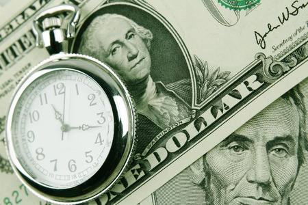 us currency: Clock and cash. Time is money Stock Photo