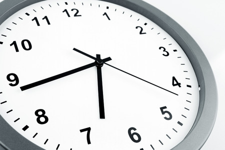 schedule appointment: Closeup of hands on clock face