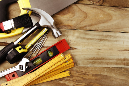 home improvement: Assorted work tools on wood
