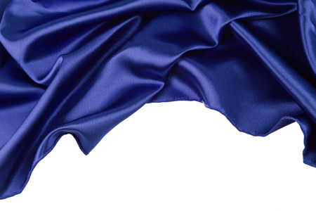 Closeup of blue silk fabric on plain background Stock Photo