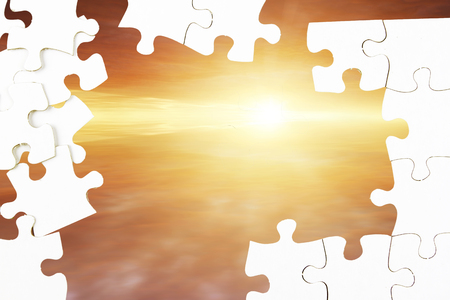 displaced: Jigsaw puzzle pieces in front of sky Stock Photo