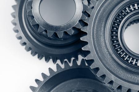 Closeup of three metal cog gears photo
