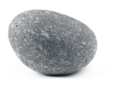 Close-up van een rots op effen achtergrond Stockfoto
